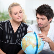 Couple organizing travel — Stock Photo