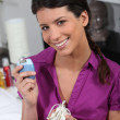 Stock Photo: Portrait of womwith epilator