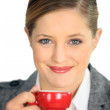 Brunette holding cup of espresso - Stock Photo