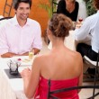 Couple having dinner in a restaurant — Stock Photo #9308795