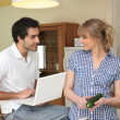 Couple in kitchen with computer — Stock Photo #9308829