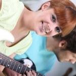 Horizontal image of girl with guitar — Stock Photo