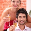 Elegant couple drinking champagne — Stock Photo