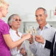 Family with champagne glasses — Stock Photo #9309227
