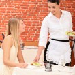 Waitress serving plate — Stockfoto #9309709