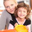 Stock Photo: Girl decorating pumpkin
