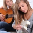 Girls playing guitar — Stock Photo #9309830