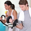 Young couple in the gym — Stock Photo #9309833
