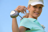 Woman with golf club and visor — Stock Photo