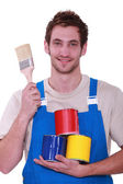 Decorator with pots of paint — Stock Photo