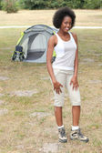 Woman stood by her tent — Stock Photo