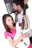 Girl and boy in a music band — Stock Photo