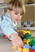 Young boy playing with toys — Stock Photo