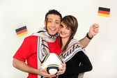 Couple supporting the German football team — Стоковое фото