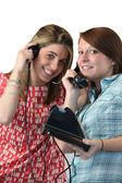 Teens with old phone — Stock Photo