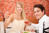 Couple toasting with pink wine — Stock Photo