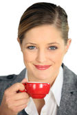 Brunette holding cup of espresso — Stock Photo