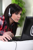 Young woman downloading music — Stock Photo