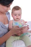 Baby sister looking at phone — Stock Photo
