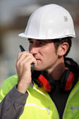 Foreman communication via radio — Stock Photo