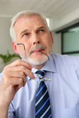 An experienced businessman deep in thought — Stock Photo