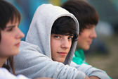 Three teenagers sat together — Stock Photo