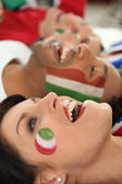 Close up of faces of joyful italian soccer supporters — Stock Photo