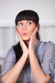 Portrait of surprised brunette — Stock Photo