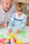 Grandfather playing with grandson — Stock Photo