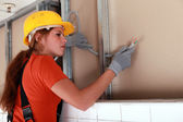 Female electrician at work — Stock Photo