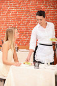Waitress serving plate — Stock Photo