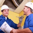 Stock Photo: Electricians exchanging views