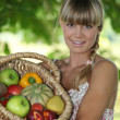 Royalty-Free Stock Photo: Woman with basket of fruit