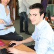 Young working in an office — Stock Photo #9311557