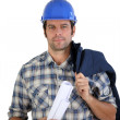 Engineer holding plans — Stock Photo #9311927