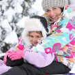 Mother and daughter in the snow — Stock Photo
