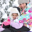 Stock Photo: Mother and daughter in the snow