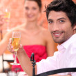 Couple toasting in restaurant - Stock Photo