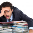 Stressed man under lots of pressure at work — Stock Photo