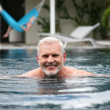 Stock Photo: Senior min swimming pool