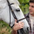 Royalty-Free Stock Photo: Teen stroking horse