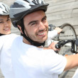 Stock Photo: Couple on bicycle