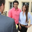 Estate-agent with young couple — Foto Stock