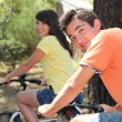 Couple cycling in the countryside — Stock Photo