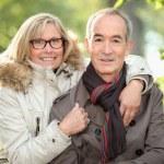 Senior couple in the woods — Stock Photo