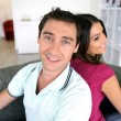 Couple back to back at home — Stock Photo #9313896