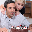 Stock Photo: Couple blowing candle