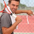 Girl with tennis racket — Stock Photo