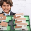 Royalty-Free Stock Photo: Little boy pretending to be architect