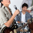 Female singer in a band — Stock Photo